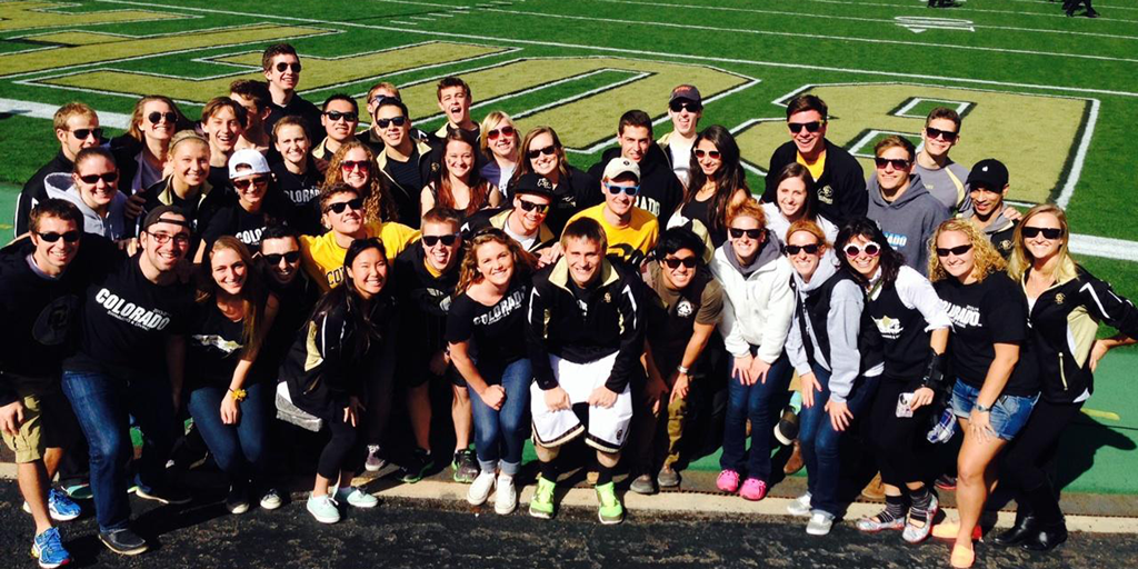 CU Swim Team on the football field